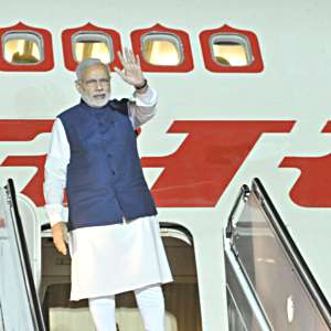 PM-NaMo-returning-from-USA